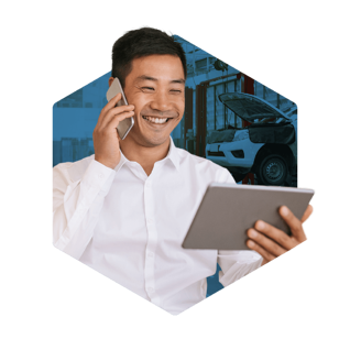 Happy businessman holding a tablet in one hand and a smartphone on the other
