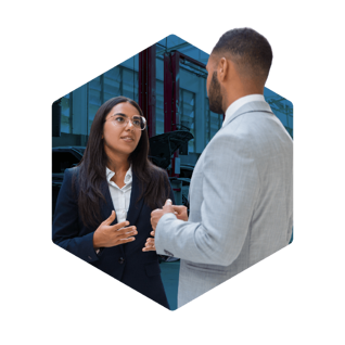 Businesswoman and businessman discussing together