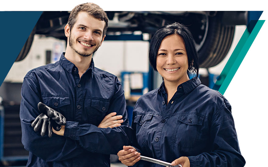 A pair of enthusiastic auto technicians in the service drive